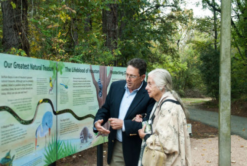 Dedication of panels at Bayou Preservation Association, two people looking at panels